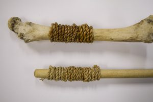 Bone and stick with wrapped cording