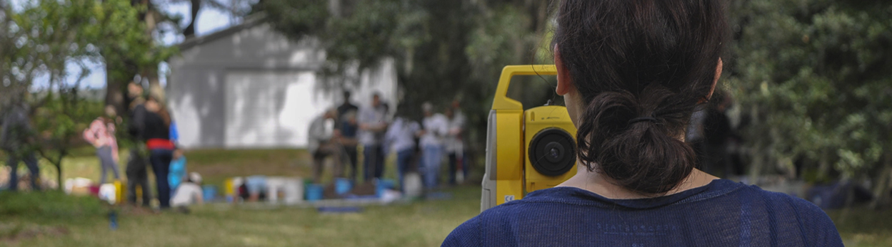 UNF students working with total station equipment